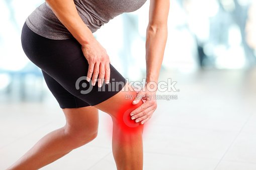 Pain in knee : Stock Photo