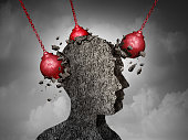 Painful Headache pain and pounding migraine concept as a human head made of cement being destroyed or renovated by a group of wrecking ball objects as a symbol for personal change as a 3D illustration