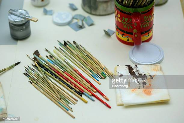 Paint brushes sit on a workbench during traditional Christmas tree ornament manufacture at Wendt Kuehn KG in Gruenhainichen Germany on Thursday Nov...