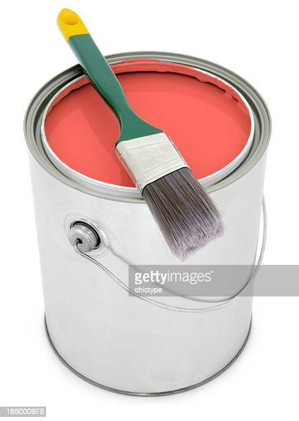 Paint bucket filled with red orange paint with brush