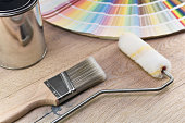 Paint bucket with paint brush, roller, palette color and paint can