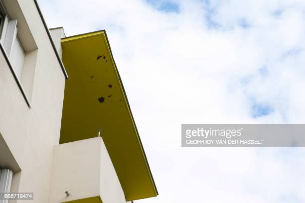 Paint comes off a roof covering a balcony of an HLM building that is part of the HLM housing estate of AulnaysousBois a commune in the...