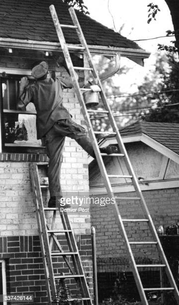 Paint Painters Painter Poised on Precarious Perch Bob Coleman from the state of Washington puts a first coat of primer on a home at 403 S Downing St...