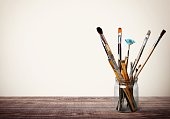 Brushes on wooden floor  background.