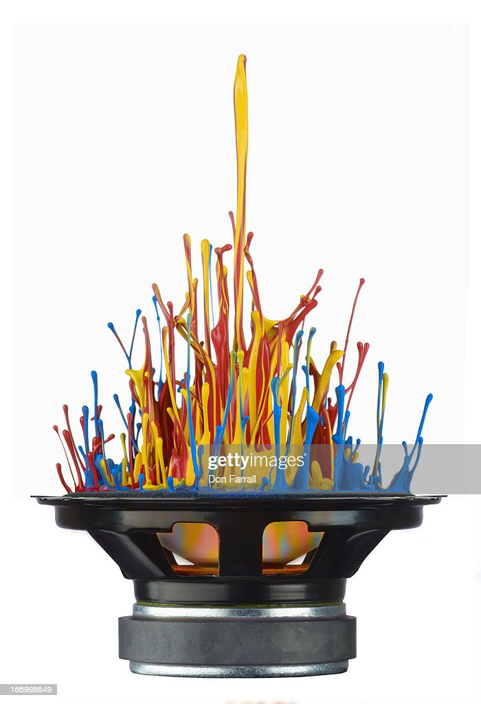 Paint, propelled from a speaker : Stock Photo
