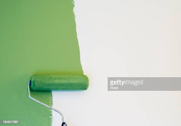 Paint Roller Painting a Wall