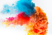 Red, yellow and blue colors paint splash on a white background.