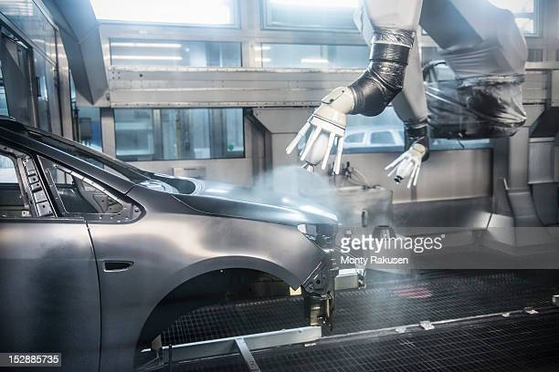 Paint spraying robots in car factory