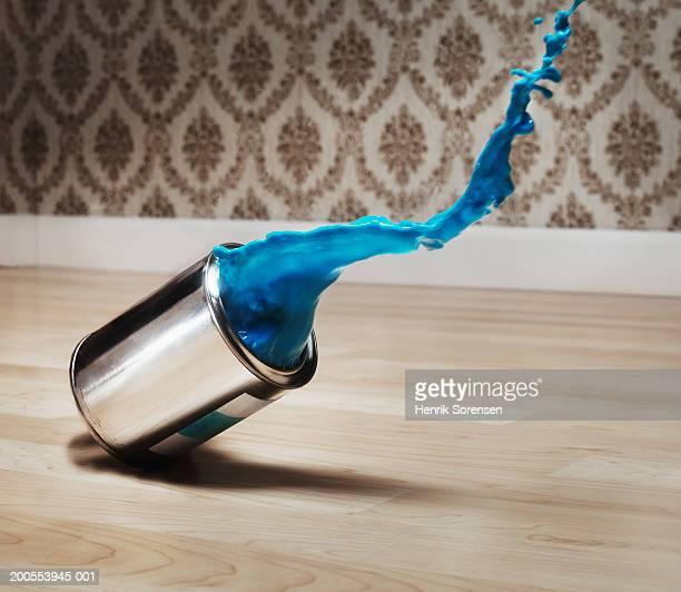 Paint tin falling on floor, close-up