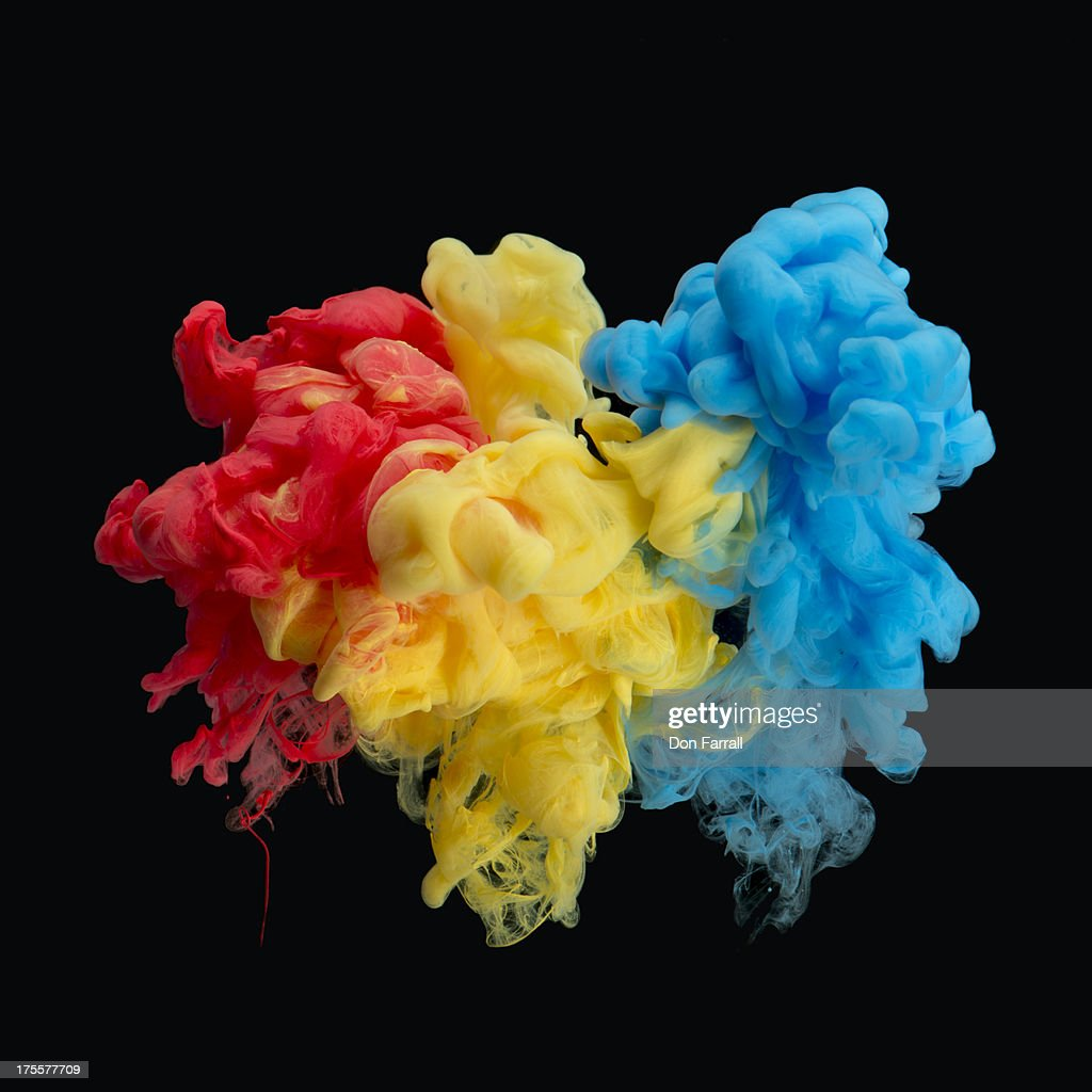 Paint under water, red yellow blue : Stock Photo