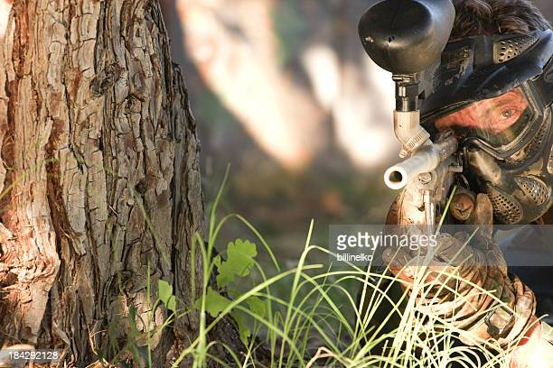 Paintball Player by Tree