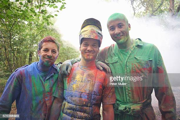 Paintball players in paintball wear marked with paint
