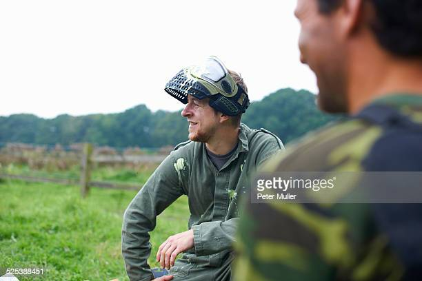 Paintball players preparing and planning game