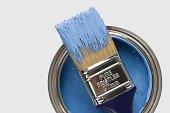 Paintbrush and blue paint