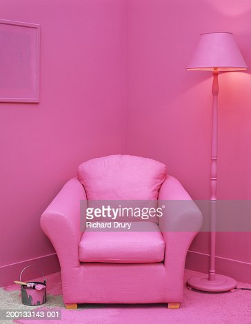 Paintbrush and can on floor in room with furniture painted pink