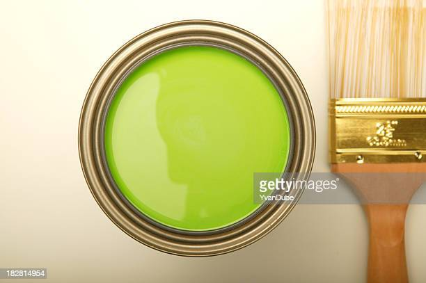 paintbrush and green paint can