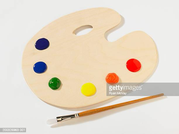 Paintbrush beside palette, elevated view