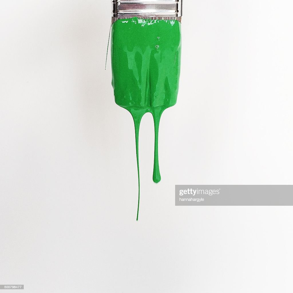 Paintbrush with green paint