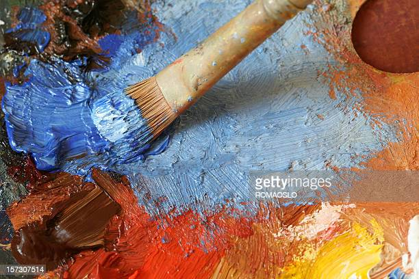 Paintbrush with oil paint on a classical palette - XL