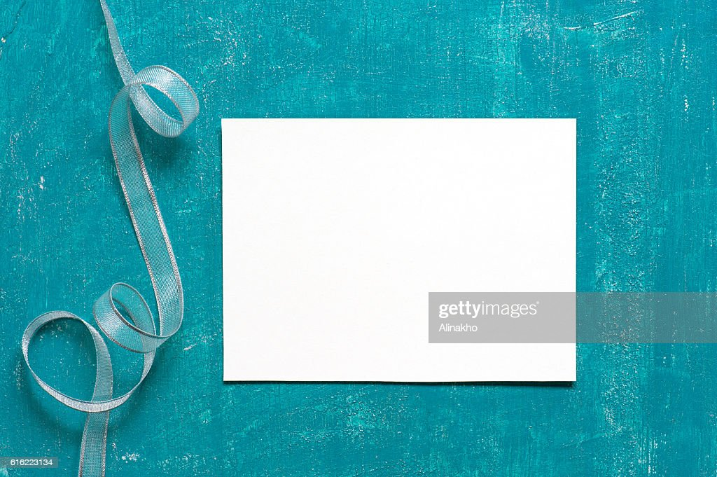 Painted aged blue background with blank sheet of paper : Stock Photo