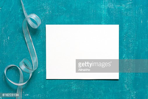 Painted aged blue background with blank sheet of paper : Foto stock