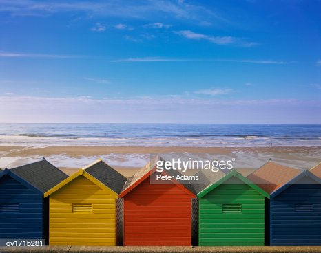 Painted Beach Huts in a Line, Whitby, England, UK : Stock Photo