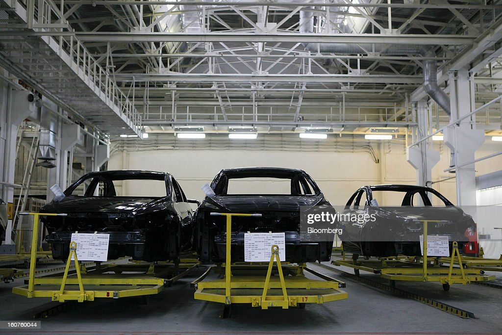 Painted bodies for Chevrolet Aveo automobiles, a division of General Motors Co. (GM), stand on trailers during assembly on the production line at the GAZ Group plant in Niznhy Novgorod, Russia, on Tuesday, Feb. 5, 2013. GAZ, which is controlled by Russian billionaire Oleg Deripaska, plans to make 30,000 Aveo sedans and hatchbacks a year at its plant in Nizhny Novgorod starting in mid-2012. Photographer: Alexander Zemlianichenko Jr./Bloomberg via Getty Images