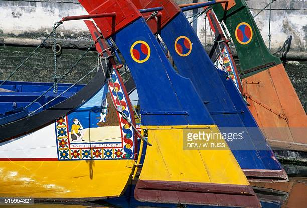 Painted bows of a typical boats known as a moliceiro Cascais Portugal
