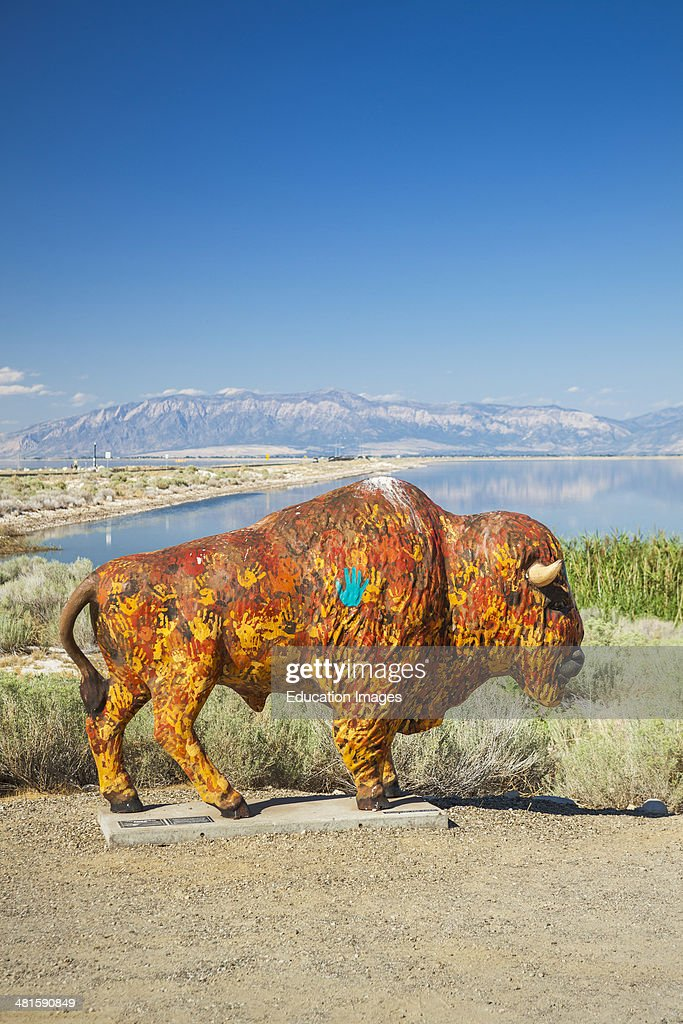 Painted buffalo statue on Antelope Island with the Great Salt Lake in background Utah