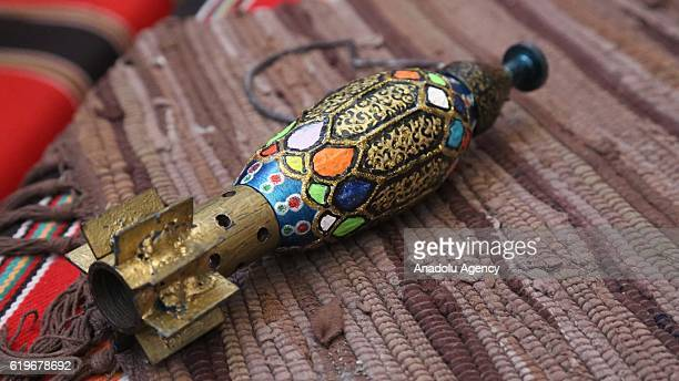 Painted capsules are seen as Syrian artist Akram Abu alFaiz paints rocket capsules empty shell casings and missiles which he collects for 5 years...