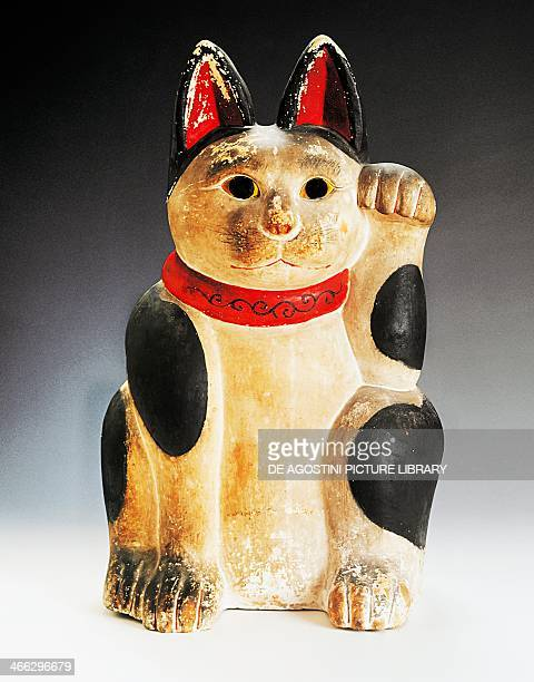 Painted clay figurine depicting Manekineko cat with its paw raised as a sign of invitation used at the entrance of shops and restaurants 19th century...