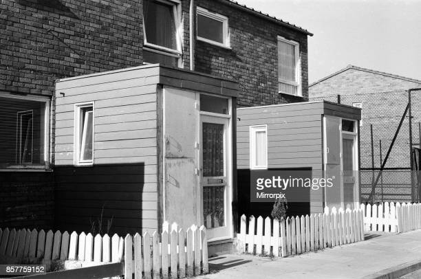 Painted council houses and the unpainted ones part of a battle of home buying at a council estate in Battersea 24th October 1980