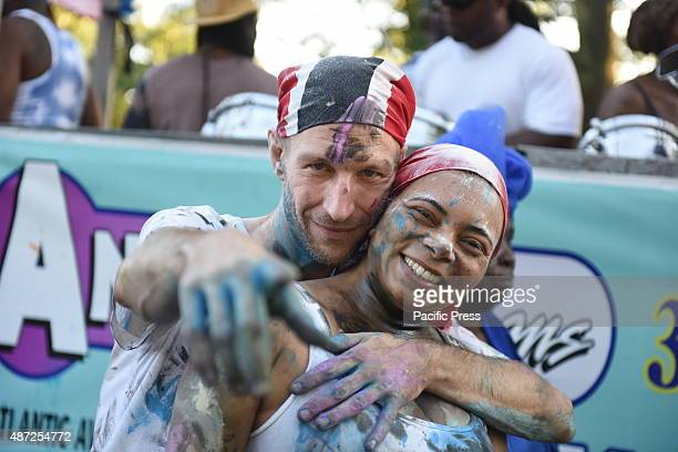 Painted couple pause for a picture The annual J'ouvert celebration made its way along Flatbush Avenue from Grand Army Plaza