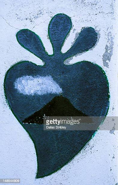 Painted detail of heart with volcano interior on wall.
