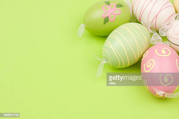 Painted Easter eggs in pastel colors on a lime background