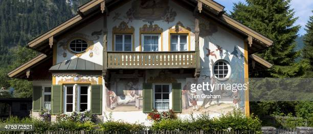 Painted facade of Grimms Fairy Tale story of Little Red Riding Hood in the village of Oberammergau in Bavaria Germany
