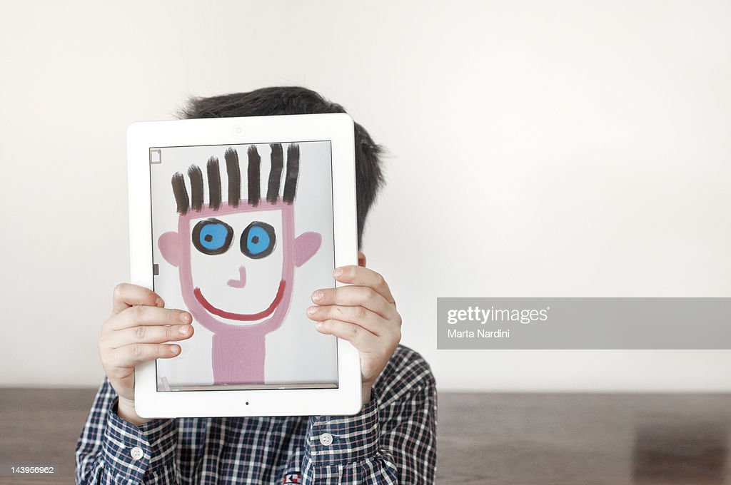 Painted face on tablet : Stock Photo
