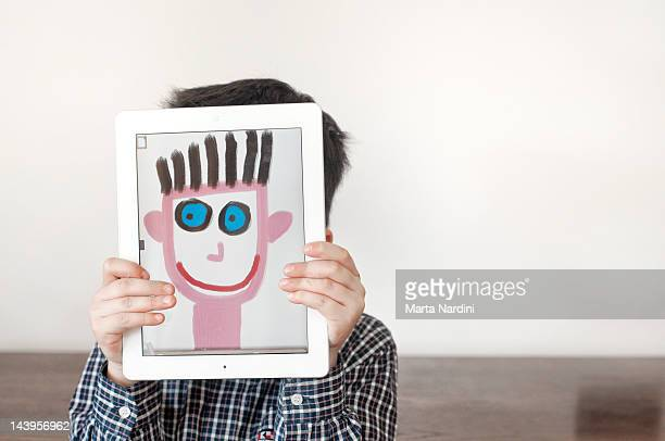 Painted face on tablet