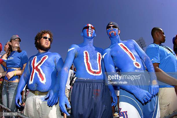 Painted fans of the University of Kansas watch the game against Texas Tech in the first half at Memorial Stadium on September 25 2004 in Kansas City...