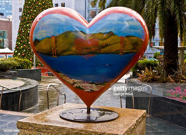 A painted heartshaped sculpture in Union Square is viewed on December 22 in San Francisco California Despite cold and rainy weather San Francisco is...
