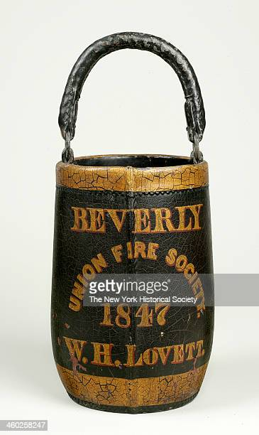Painted leather fire bucket with leatherencased rope handle 1847 Cylindrical shape with inward curve at bottom standing draped nude male figure...