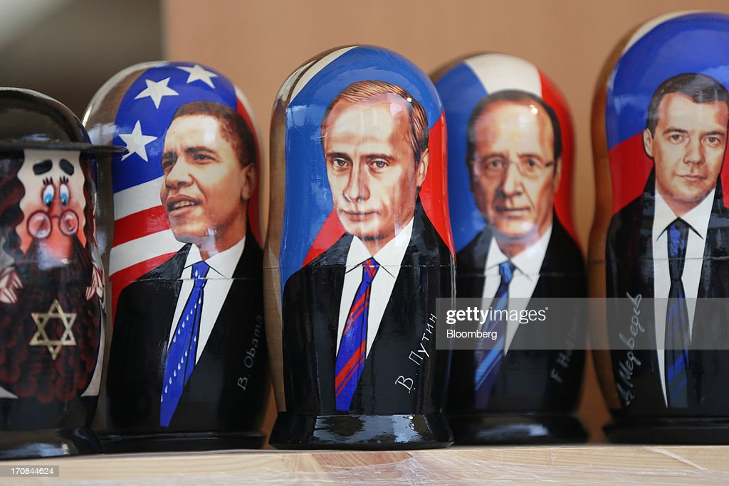 Painted matryoshka dolls portraying world leaders including, left to right, U.S. President Obama, Russia's President Putin, France's President Hollande and Russia's Prime Minister Medvedev, sit for sale at a souvenir stall ahead of the St. Petersburg International Economic Forum 2013 (SPIEF) in St. Petersburg, Russia, on Wednesday, June 19, 2013. The Russian Deputy Prime Minister Igor Shuvalov told the conference that the country's World Trade Organization accession negotiations could be further delayed unless several remaining disputed matters are solved. Photographer: Andrey Rudakov/Bloomberg via Getty Images
