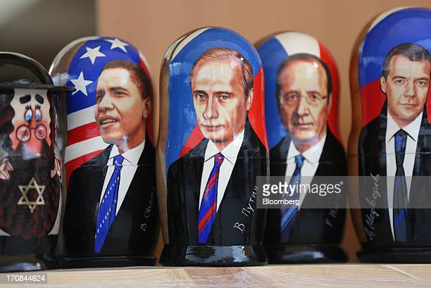Painted matryoshka dolls portraying world leaders including left to right US President Obama Russia's President Putin France's President Hollande and...