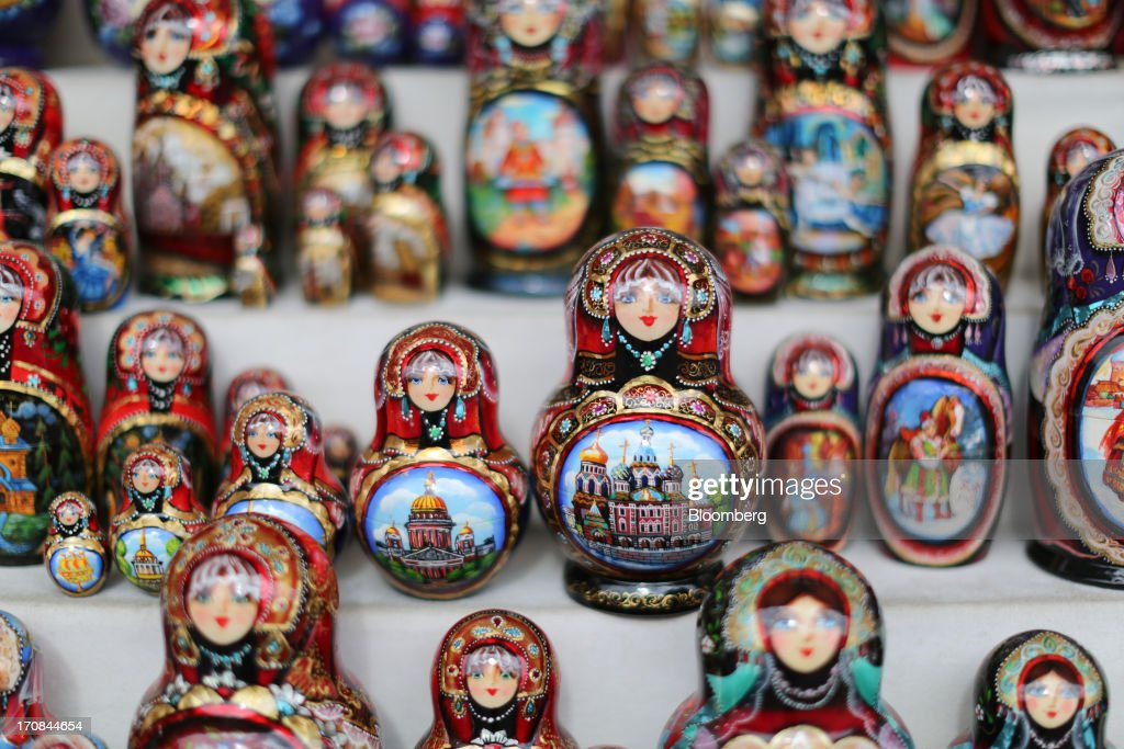 Painted matryoshka dolls sit for sale at a tourist stall ahead of the St. Petersburg International Economic Forum 2013 (SPIEF) in St. Petersburg, Russia, on Wednesday, June 19, 2013. The Russian Deputy Prime Minister Igor Shuvalov told the conference that the country's World Trade Organization accession negotiations could be further delayed unless several remaining disputed matters are solved. Photographer: Andrey Rudakov/Bloomberg via Getty Images