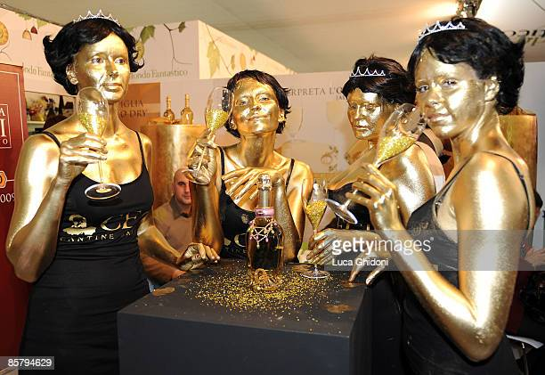 Painted Models pose with a glass at the Vinitaly on April 3 2009 in Verona Italy Vinitaly the international wine and spirit exhibition runs April 26