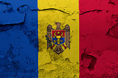 Painted national flag of Moldova on a concrete wall