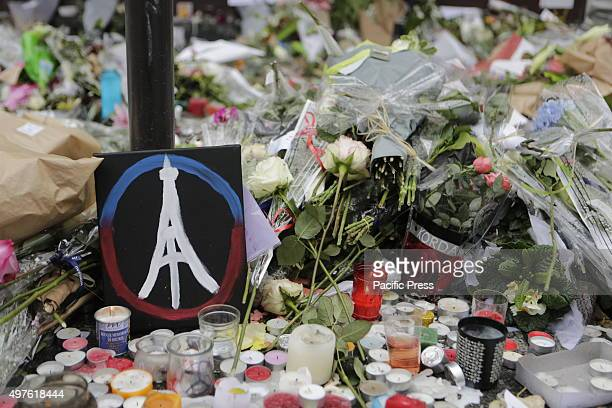 A painted peace sign with the Eiffel Tower in it has been placed at the memorial outside the restaurant Le Petit Cambodge for the people killed here...