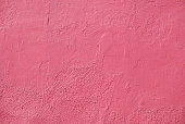 Painted pink wall texture, textured background