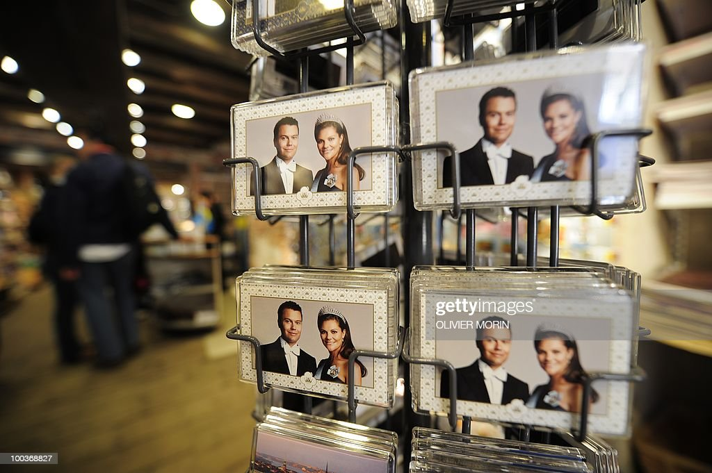 Painted playing cards of Swedish crown Princess Victoria and her fiance Daniel Westling are displayed on a rack in a souvenir shop near the Royal Castle in Stockholm on May 24, 2010, where the royal wedding will be held. Many tourists paid a visit to the Swedish capital less than a month before Crown Princess Victoria 's wedding, the 32-year-old eldest daughter of King Carl XVI Gustaf.
