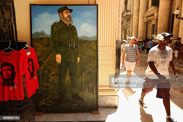 A painted portrait of former Cuban President Fidel Castro stands in the doorway of a museum in the old part of the city August 13 2015 in Havana Cuba...